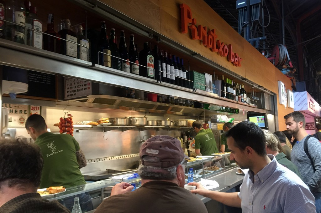 Chef Jose orders for us at Pinoxto in La Boqueria